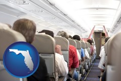 florida map icon and airline passengers in a commercial jetliner