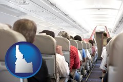 idaho map icon and airline passengers in a commercial jetliner