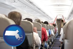 massachusetts map icon and airline passengers in a commercial jetliner