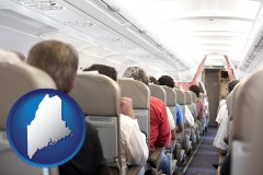 maine map icon and airline passengers in a commercial jetliner