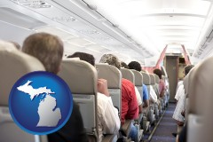 michigan map icon and airline passengers in a commercial jetliner