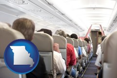 missouri map icon and airline passengers in a commercial jetliner