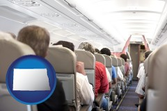 north-dakota map icon and airline passengers in a commercial jetliner