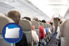 oregon map icon and airline passengers in a commercial jetliner