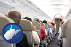 west-virginia map icon and airline passengers in a commercial jetliner