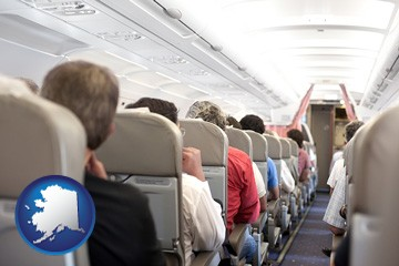 airline passengers in a commercial jetliner - with Alaska icon