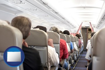 airline passengers in a commercial jetliner - with Colorado icon
