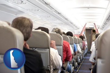 airline passengers in a commercial jetliner - with Delaware icon