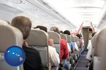 airline passengers in a commercial jetliner - with Hawaii icon