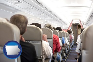 airline passengers in a commercial jetliner - with Iowa icon