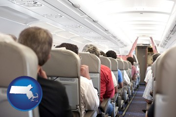 airline passengers in a commercial jetliner - with Massachusetts icon