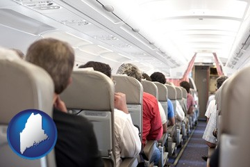 airline passengers in a commercial jetliner - with Maine icon