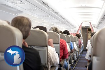 airline passengers in a commercial jetliner - with Michigan icon