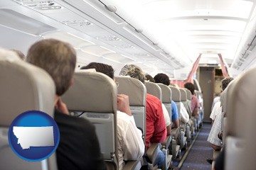 airline passengers in a commercial jetliner - with Montana icon