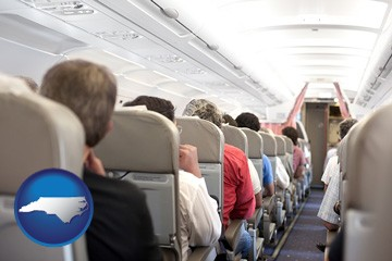 airline passengers in a commercial jetliner - with North Carolina icon