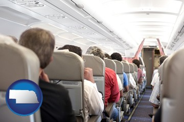 airline passengers in a commercial jetliner - with Nebraska icon