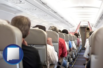 airline passengers in a commercial jetliner - with New Mexico icon
