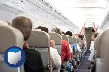 airline passengers in a commercial jetliner - with Ohio icon