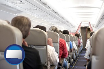 airline passengers in a commercial jetliner - with South Dakota icon