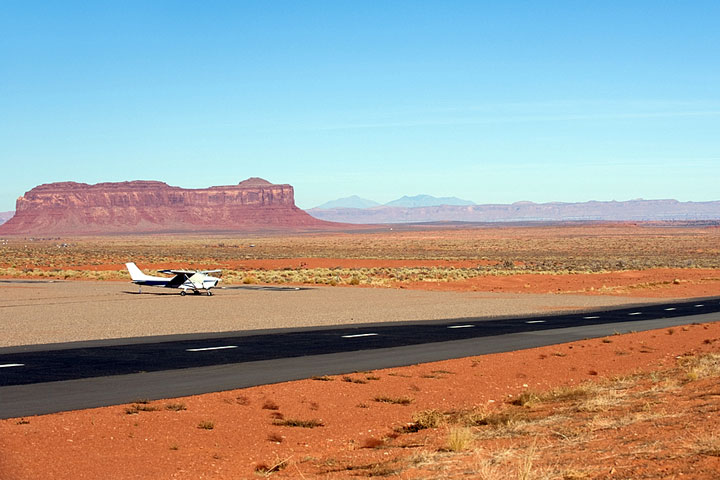 small airplane and landing strip at Monument Valley, Arizona